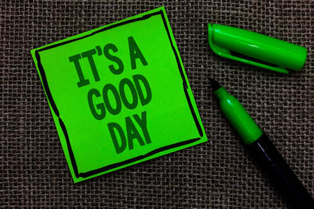 Writing note showing It s is A Good Day. Business photo showcasing Happy time great vibes perfect to enjoy life beautiful Black lined green sticky note with words open green pen on sack Banco de Imagens