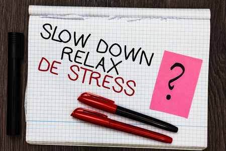 Word writing text Slow Down Relax De Stress. Business concept for Have a break reduce stress levels rest calm Color pen on written notepad with question mark black marker on woody deck