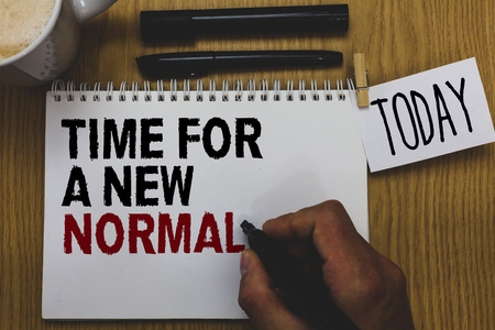 Conceptual hand writing showing Time For A New Normal. Business photo text Make a big dramatic change Replace the expected Written on paper hand hold pen clipper grip sticky note black pen