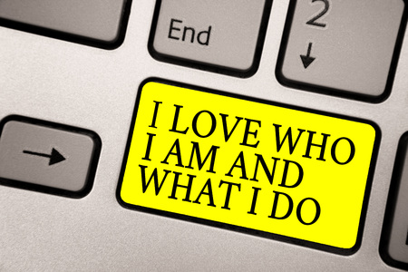 Word writing text I Love Who I Am And What I Do. Business concept for High self-stem being comfortable with your job Grey silvery keyboard with bright yellow color button black color texts Imagens