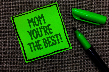 Writing note showing Mom You re are The Best. Business photo showcasing Appreciation for your mother love feelings compliment Black lined green sticky note with words open green pen on sack