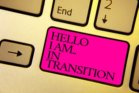 Word writing text Hello I Am.. In Transition. Business concept for Changing process Progressing planning new things Bright golden computer keyboard with pink button black color written texts Standard-Bild