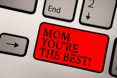 Conceptual hand writing showing Mom You re are The Best. Business photo text Appreciation for your mother love feelings compliment Greyish silver keyboard with red color button black color texts Stock Photo