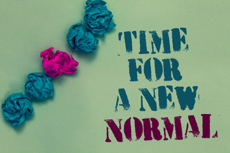 Writing note showing Time For A New Normal. Business photo showcasing Make a big dramatic change Replace the expected Drawn blue and red words teal color paper lump mid pink on blue floor