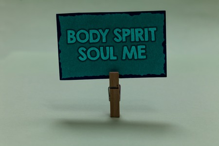 Writing note showing Body Spirit Soul Me. Business photo showcasing Personal Balance Therapy Conciousness state of mind paperclip grip black lined green page with outlines grey background Stock Photo