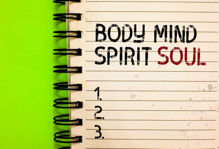 Word writing text Body Mind Spirit Soul. Business concept for Personal Balance Therapy Conciousness state of mind Written black and red text and number on white notepad green background Stockfoto
