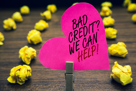 Conceptual hand writing showing Bad Credit question We Can Help. Business photo text Borrower with high risk Debts Financial Paperclip hold pink written heart woody floor with yellow lobs