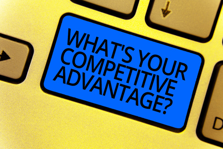 Handwriting text writing What s is Your Competitive Advantage question. Concept meaning Marketing strategy Plan Keyboard blue key Intention create computer computing reflection document