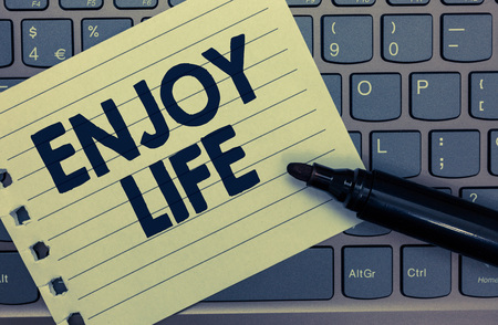 Conceptual hand writing showing Enjoy Life. Business photo showcasing Any thing, place,food or person, that makes you relax and happy Notebook paper keyboard Inspiration computer black marker
