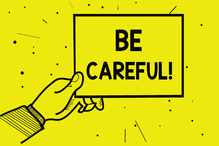 Word writing text Be Careful. Business concept for making sure of avoiding potential danger mishap or harm Man hand holding paper communicating information dotted yellow background