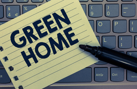 Conceptual hand writing showing Green Home. Business photo showcasing An area filled with plants and trees where you can relax Notebook paper keyboard Inspiration computer black marker 写真素材