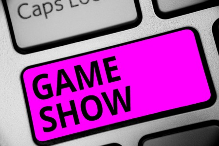 Writing note showing Game Show. Business photo showcasing Program in television or radio with players that win prizes Keyboard purple key Intention computer computing reflection document Stock Photo