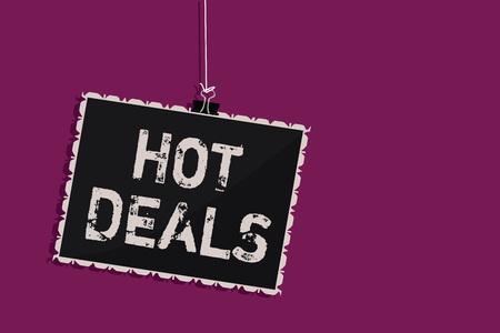 Word writing text Hot Deals. Business concept for An agreement through which one of the paties is offered and accept Hanging blackboard message communication information sign purple background Stok Fotoğraf