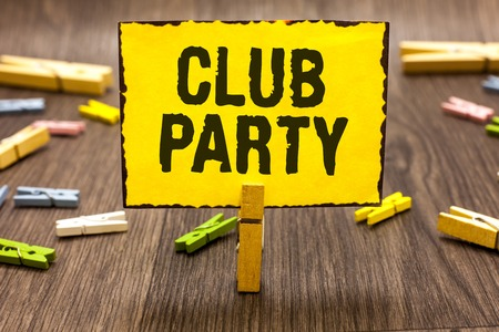 Text sign showing Club Party. Conceptual photo social gathering in a place that is informal and can have drinks Clothespin holding yellow paper note several clothespins wooden floor