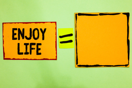 Writing note showing Enjoy Life. Stock Photo