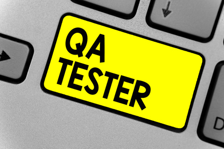 Writing note showing QA Tester. Stock fotó