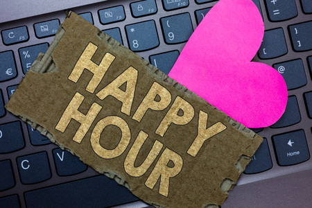 Conceptual hand writing showing Happy Hour. Business text Spending time for activities that makes you relax for a while Paperboard Romantic lovely message Heart Keyboard Type computer
