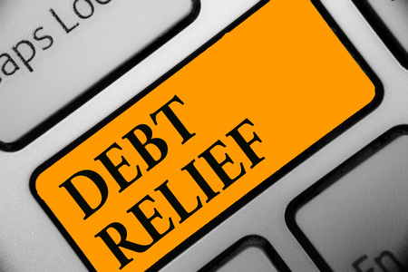 Writing note showing Debt Relief. Business photo showcasing partial or total remission of it especially those by countries Keyboard orange key Intention computer computing reflection document Stock Photo