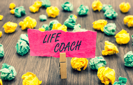 Writing note showing Life Coach. Business showcasing A person who advices clients how to solve their problems or goals Clothespin holding pink note paper crumpled papers several tries