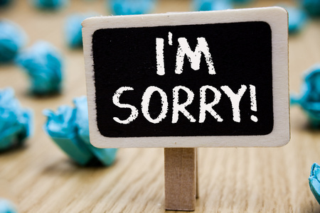 Text sign showing I am Sorry. Conceptual photo To ask for forgiveness to someone you unintensionaly hurt Blackboard crumpled papers several tries mistake not satisfied wooden floor Stock fotó