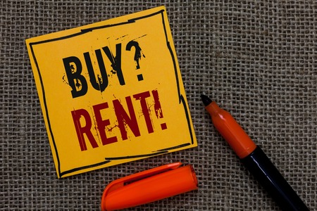 Conceptual hand writing showing Buy question Rent. Business photo showcasing Group that gives information about renting houses Orange paper Marker Communicate ideas Jute background