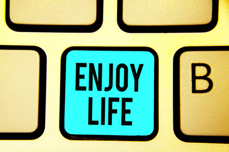 Conceptual hand writing showing Enjoy Life. Business photo showcasing Any thing, place,food or person, that makes you relax and happy Keyboard blue key computer computing reflection document