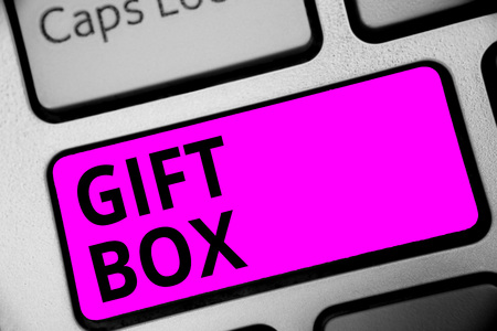Writing note showing Gift Box. Business photo showcasing A small cointainer with designs capable of handling presents Keyboard purple key Intention computer computing reflection document