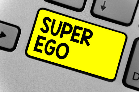 Writing note showing Super Ego. Business photo showcasing The I or self of any person that is empowering his whole soul Keyboard yellow key Intention computer computing reflection document