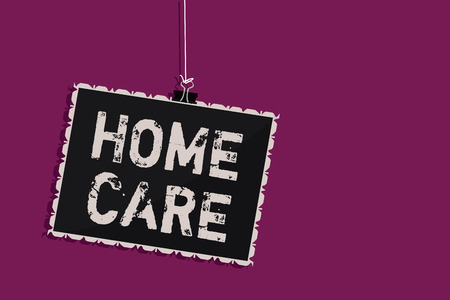 Word writing text Home Care. Business concept for Place where people can get the best service of comfort rendered Hanging blackboard message communication information sign purple background Stok Fotoğraf