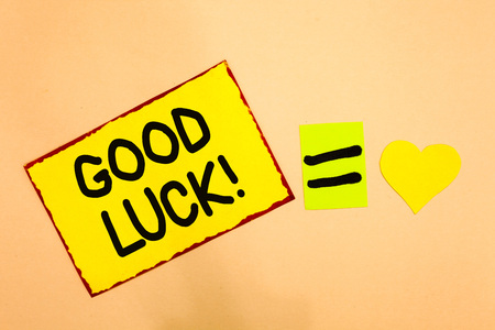 Conceptual hand writing showing Good Luck. Business photo text A positive fortune or a happy outcome that a person can have Yellow paper reminder equal sign heart sending romantic feelings