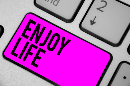 Text sign showing Enjoy Life. Conceptual photo Any thing, place,food or person, that makes you relax and happy Keyboard purple key Intention create computer computing reflection document