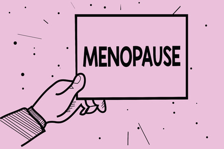 Word writing text Menopause. Business concept for Period of permanent cessation or end of menstruation cycle Man hand holding paper communicating information dotted purple background Reklamní fotografie