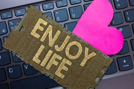 Conceptual hand writing showing Enjoy Life. Business photo text Any thing, place,food or person, that makes you relax and happy Paperboard Romantic lovely message Heart Keyboard Type computer