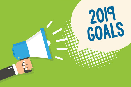 Text sign showing 2019 Goals. Conceptual photo A plan to do for something new and better for the coming year Man holding megaphone loudspeaker speech bubble green background halftone