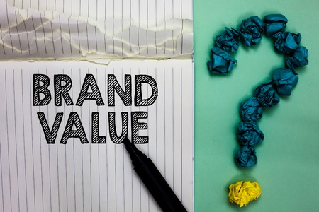Conceptual hand writing showing Brand Value. Business photo text company generates from product with recognizable for its names Notebook marker crumpled papers question mark on green background Banco de Imagens - 106480296