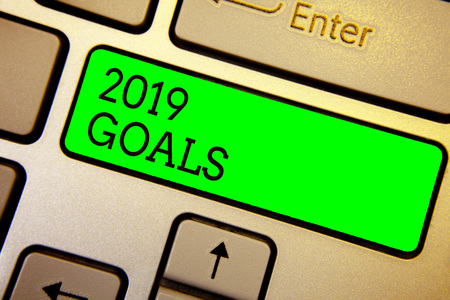Writing note showing 2019 Goals. Business photo showcasing A plan to do for something new and better for the coming year Keyboard green key Intention computer computing reflection document