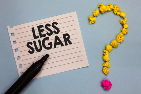 Word writing text Less Sugar. Business concept for Lower volume of sweetness in any food or drink that we eat Paper marker crumpled papers forming question mark wooden background