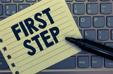 Conceptual hand writing showing First Step. Business photo showcasing Pertaining to the start of a certain process or beginning Notebook paper keyboard Inspiration computer black marker