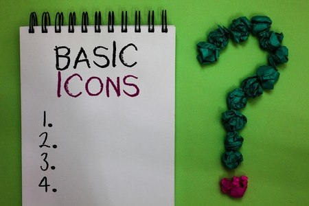 Text sign showing Basic Icons. Conceptual photo pictogram or ideogram displayed on a computer screen or phone Open notebook crumpled papers forming question mark green background