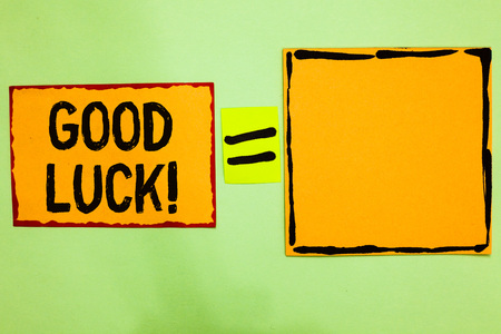 Writing note showing Good Luck. Business photo showcasing A positive fortune or a happy outcome that a person can have Orange paper notes reminders equal sign important messages to remember 写真素材