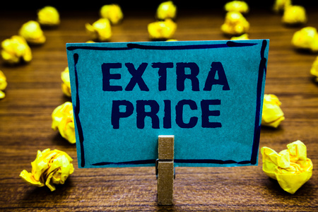 Word writing text Extra Price. Business concept for extra price definition beyond the ordinary large degree Clothespin holding blue paper note crumpled papers several tries mistakes Foto de archivo