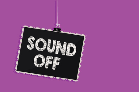 Text sign showing Sound Off. Conceptual photo To not hear any kind of sensation produced by stimulation Hanging blackboard message communication information sign purple background