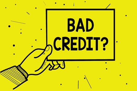 Word writing text Bad Credit question. Business concept for history when it indicates that borrower has high risk Man hand holding paper communicating information dotted yellow background