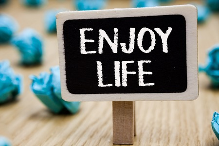 Text sign showing Enjoy Life. Conceptual photo Any thing, place,food or person, that makes you relax and happy Blackboard crumpled papers several tries mistake not satisfied wooden floor Stock Photo