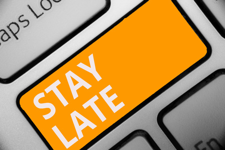 Writing note showing Stay Late. Stock Photo