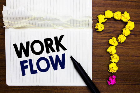 Writing note showing Work Flow. Business photo showcasing Continuity of a certain task to and from an office or employer Notebook marker crumpled paper forming question mark wooden background