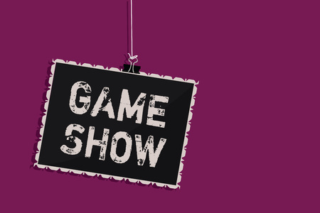Word writing text Game Show. Business concept for Program in television or radio with players that win prizes Hanging blackboard message communication information sign purple background