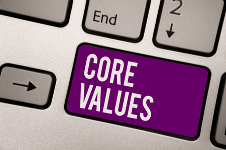 Conceptual hand writing showing Core Values. Business photo showcasing belief person or organization views as being importance Keyboard purple key computer computing reflection document