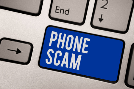 Writing note showing Phone Scam. Business photo showcasing getting unwanted calls to promote products or service Telesales Keyboard blue key Intention computer computing reflection document
