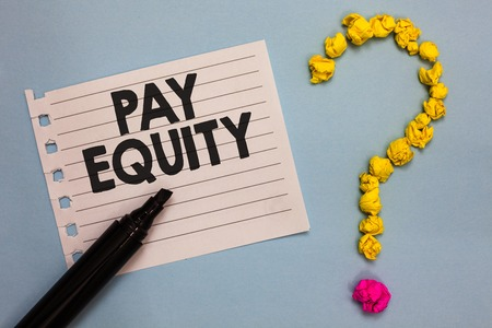 Word writing text Pay Equity. Business concept for eliminating sex and race discrimination in wage systems Paper marker crumpled papers forming question mark wooden background Stock Photo